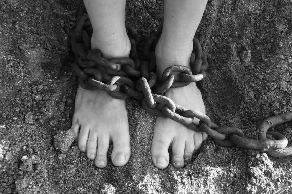 feet with chains in black and white