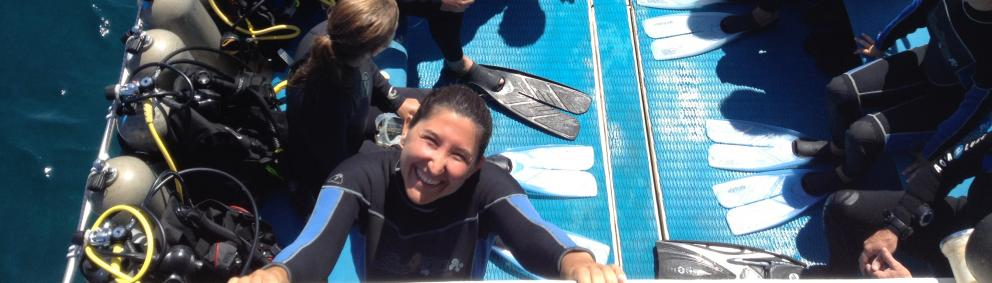 Lucia on a boat wearing a wetsuit