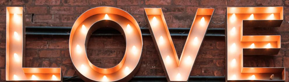 Love sign with lightbulbs